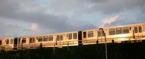 The El Train going by at sunset