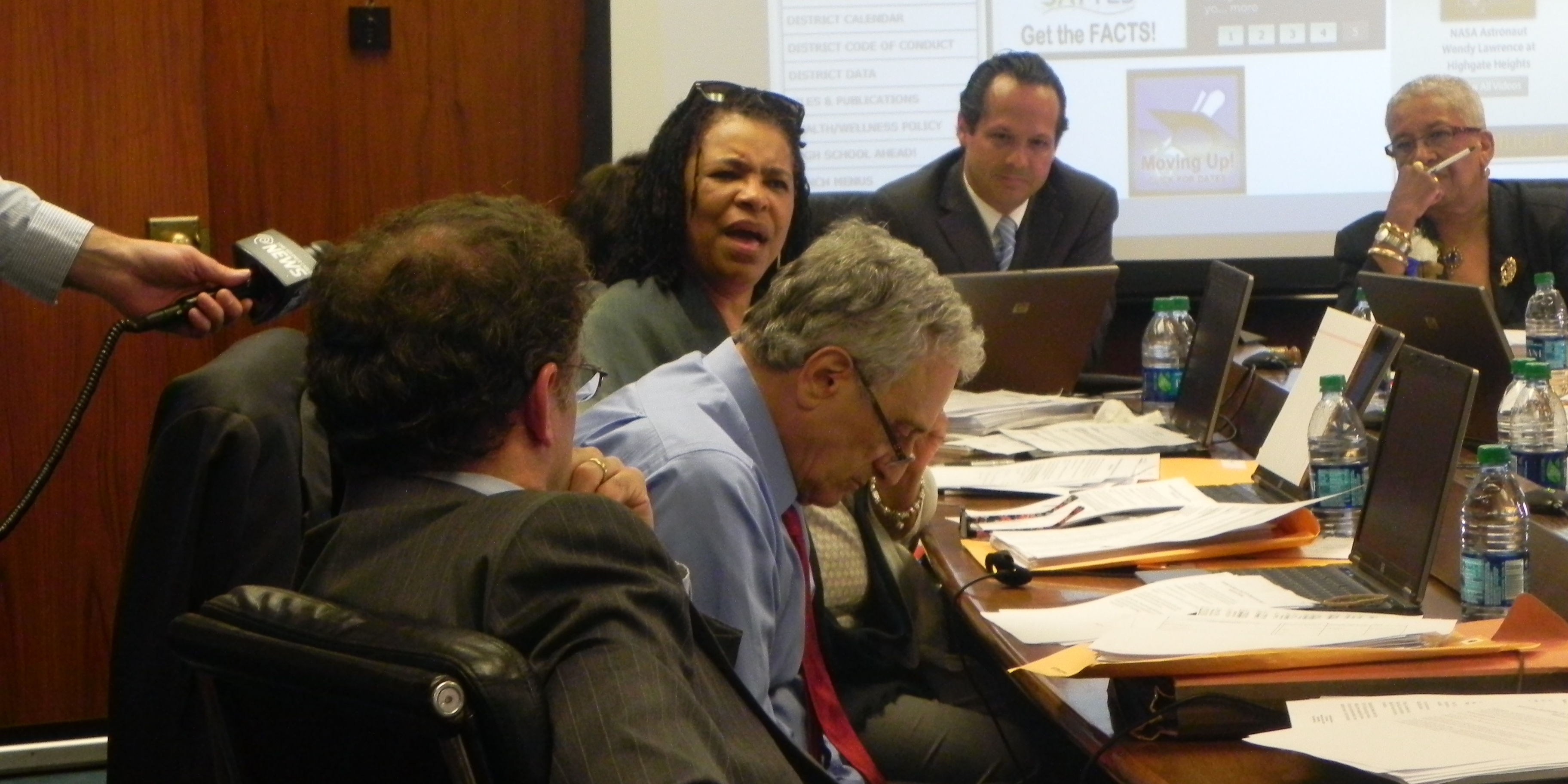 Dr. Theresa Harris-Tigg, a professor of education at Buffalo State College, exchanging words with Carl Paladino, with Interim Superintendent Will Kerezetes and Dr. Barbara Nevergold.