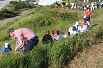 Search for Garrick Porteous' ball down 18's cliff.