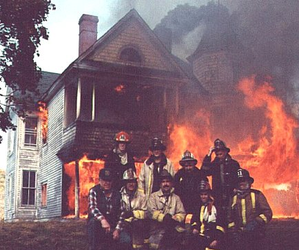 firefighters-in-front-of-house-fire