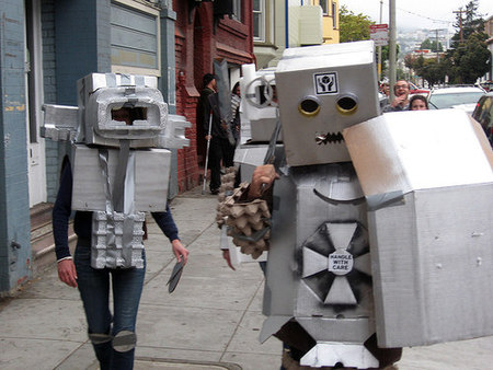 people in cheap robot costumes