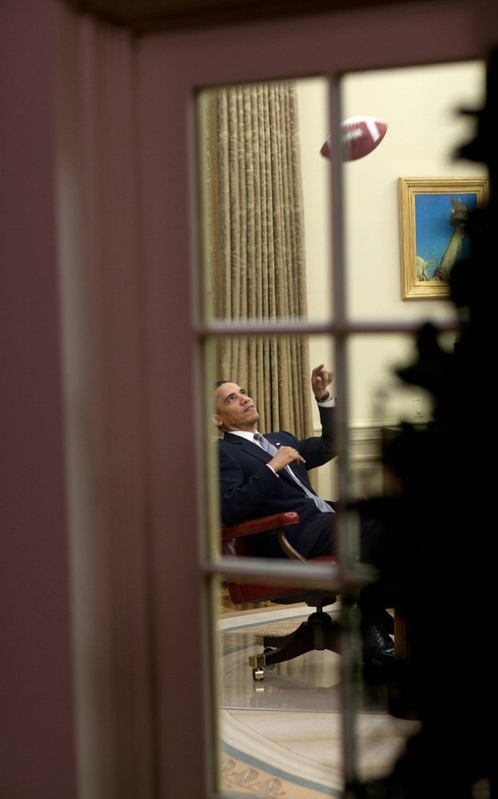 Barack Obama tossing a football in his office