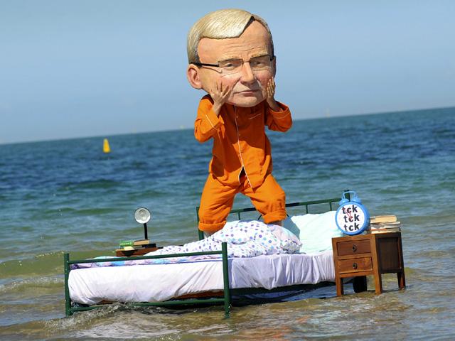 man in costume on bed in ocean