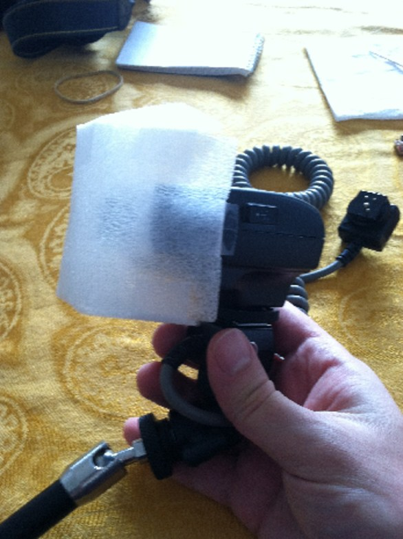 DiY flash diffuser made of plastic foam sheeting attached to Meike MK-300 flash.