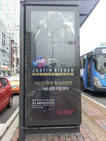At a Seoul bus stop...