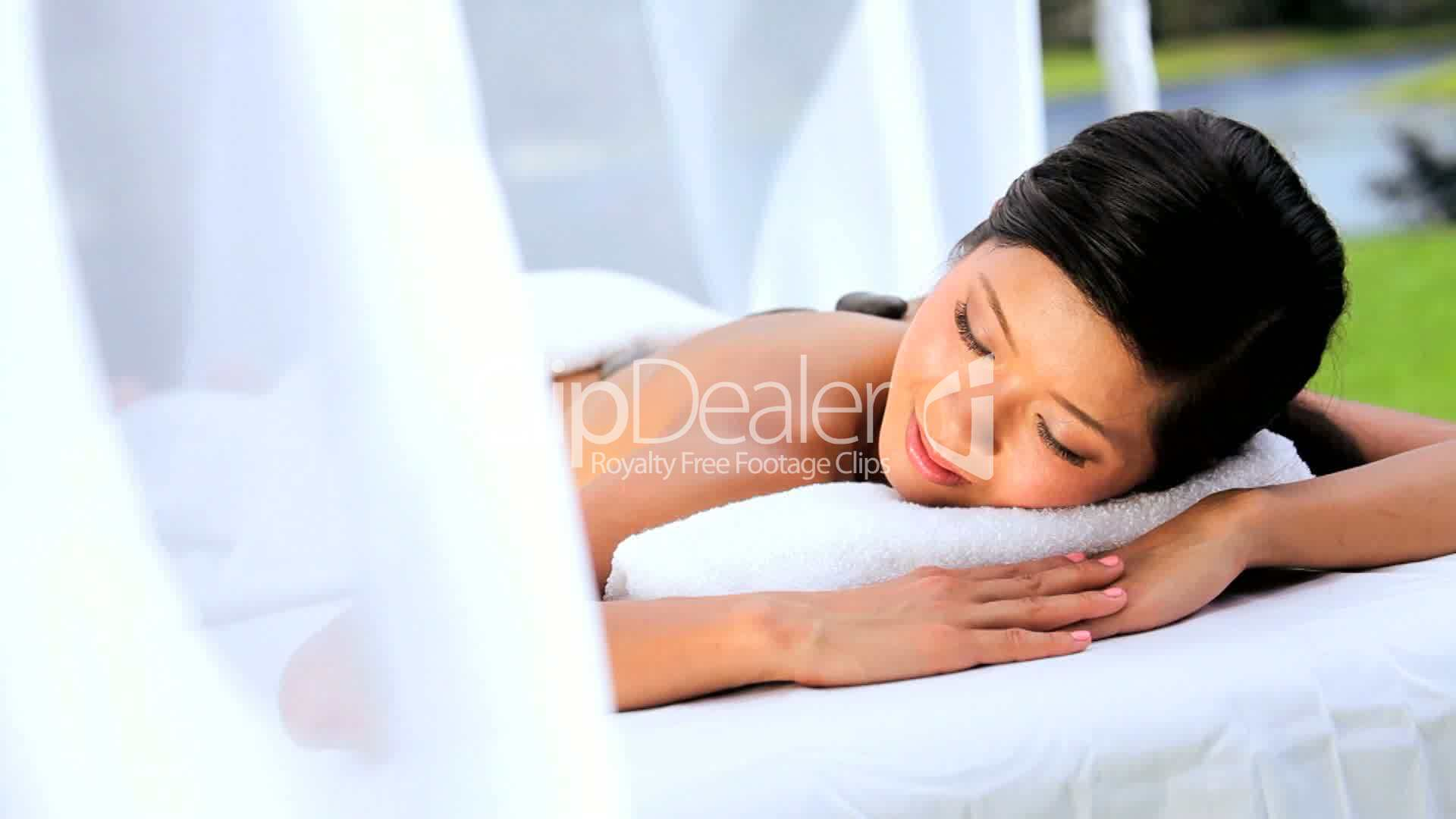 Asian Girl Relaxing with Hot Stone Massage Royaltyfree video and stock footage