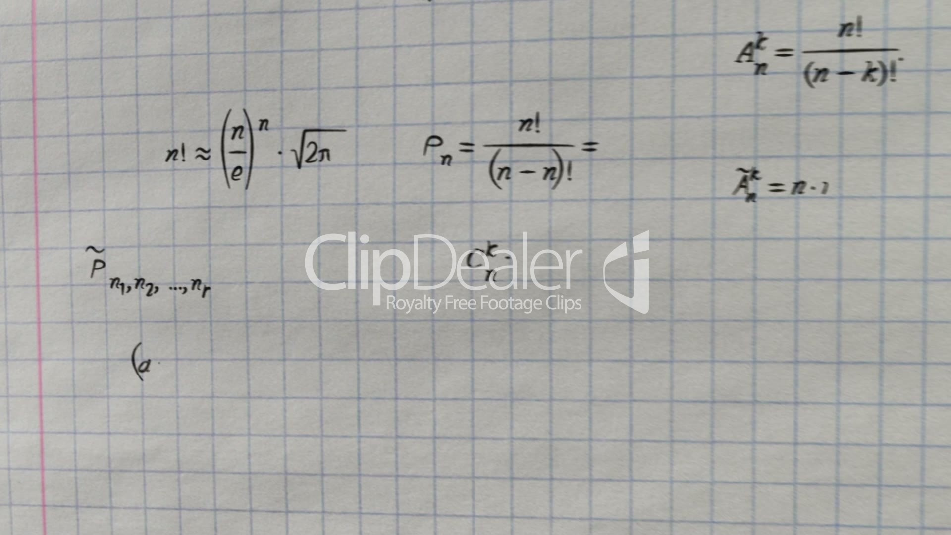 math physics formulas on squared exercise book flying