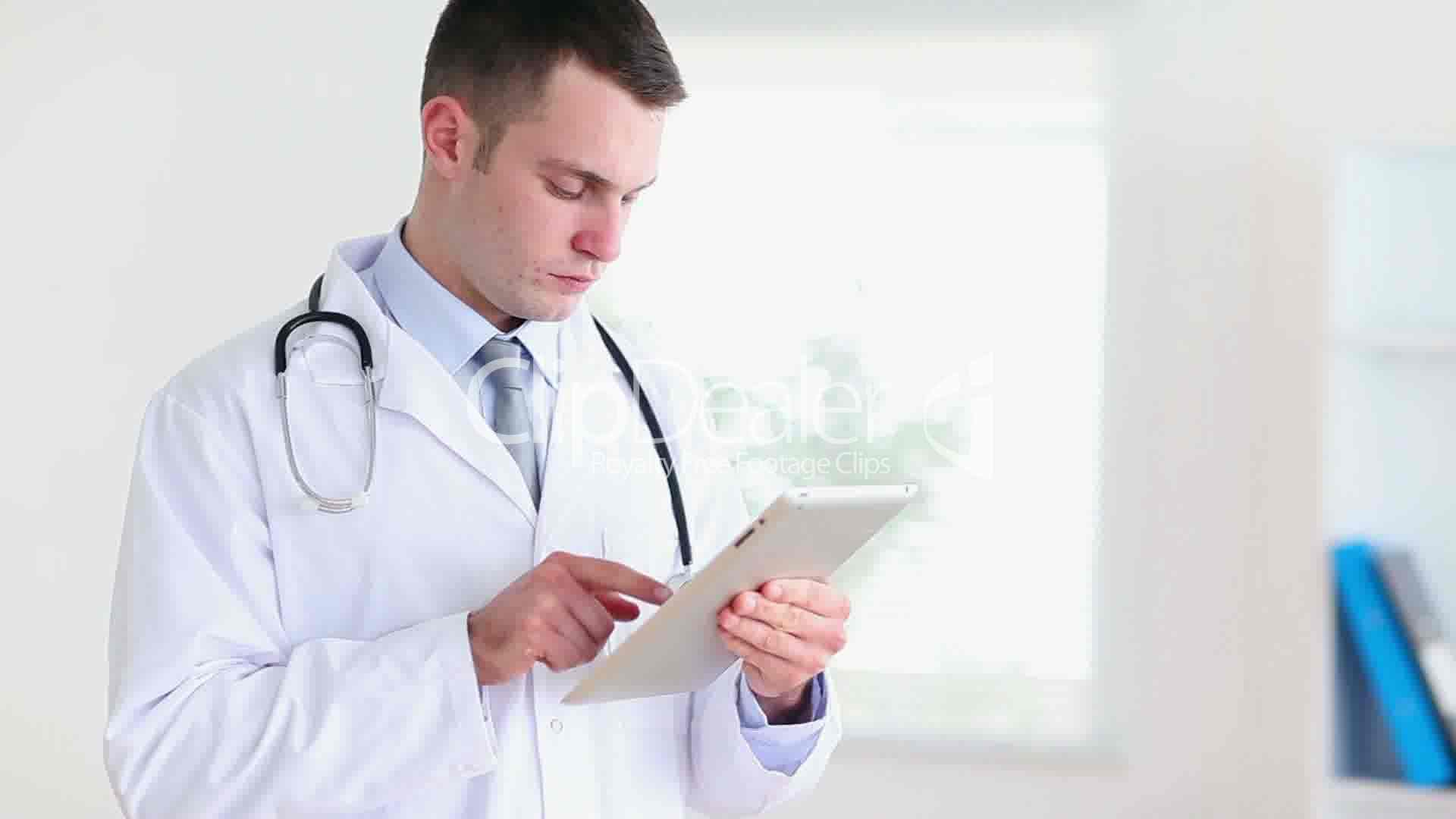 Young doctor using a tablet computer Royaltyfree video