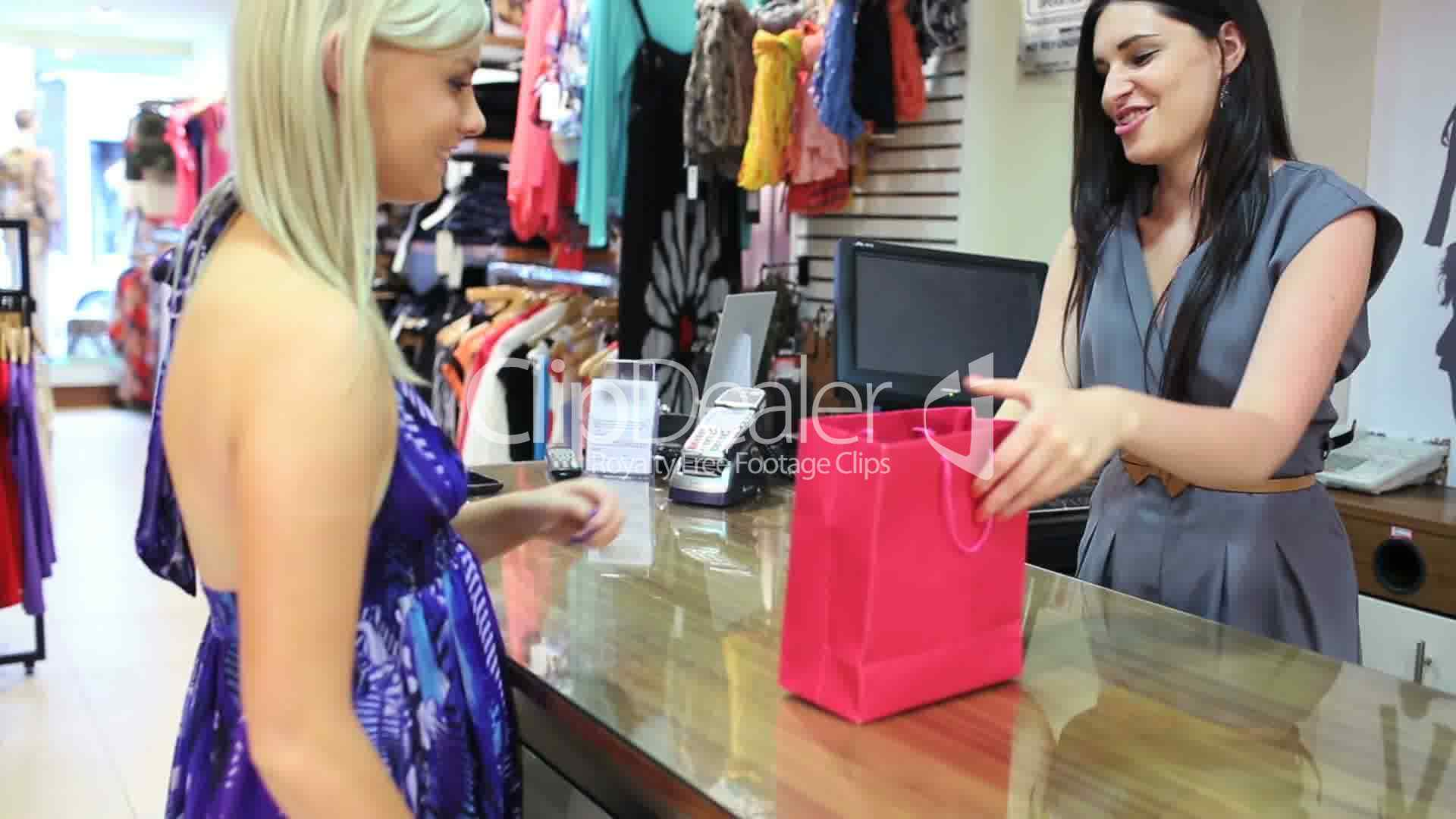 Woman buying clothes at till Royaltyfree video and stock