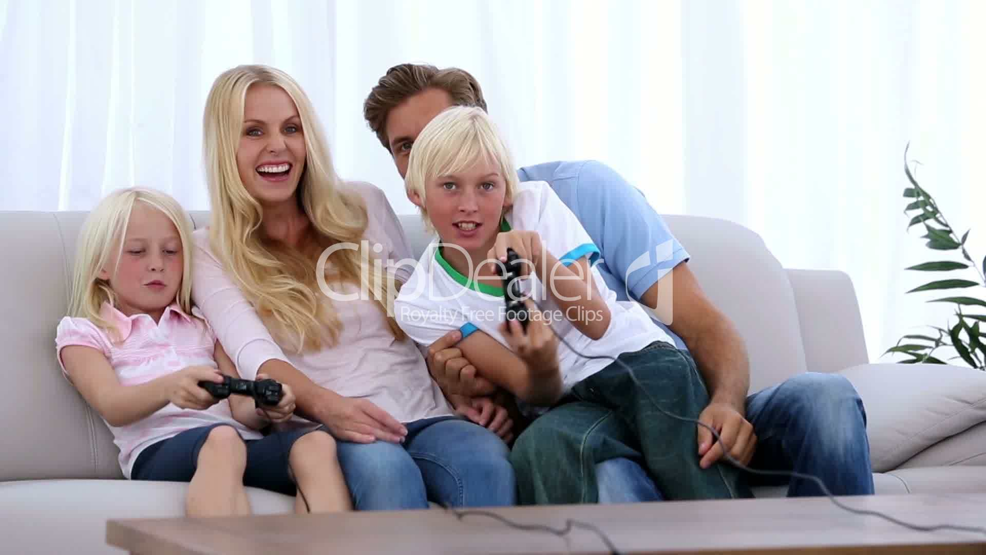 Family playing video games together Royaltyfree video