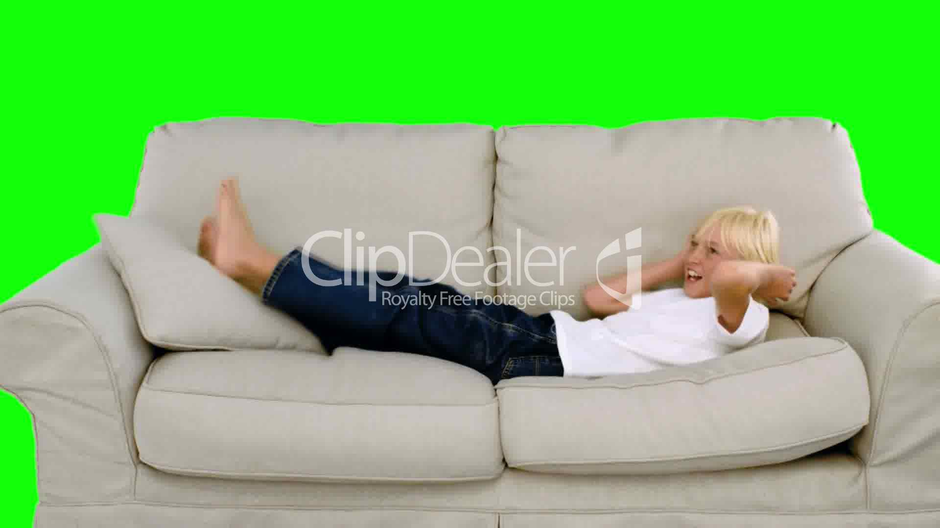 motion sofa definition modern sectional sofas miami young boy jumping on the green screen royalty