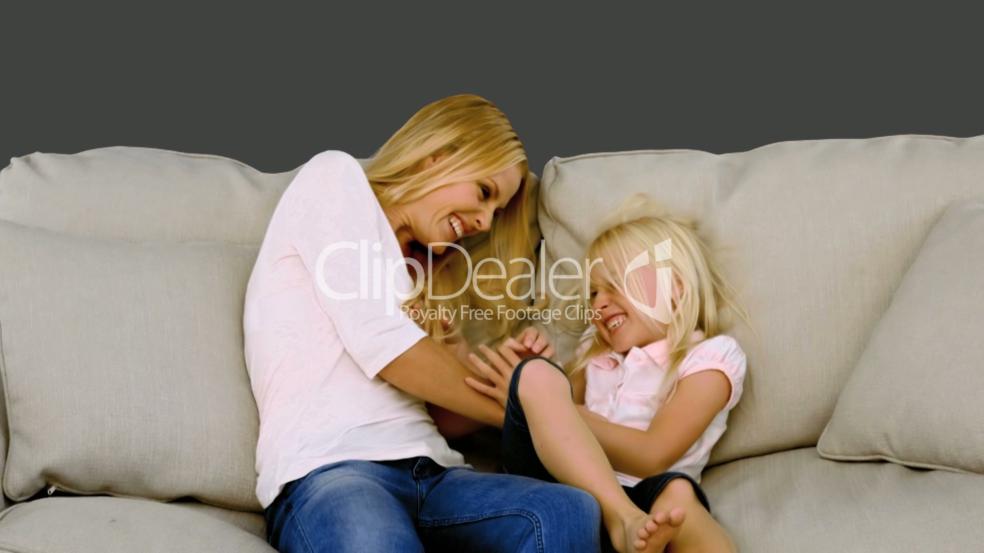 motion sofa definition mckinley leather costco mother tickling her daughter on sofa: royalty-free video ...