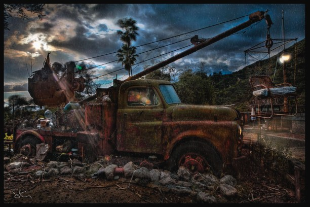 Old truck with a chair on a boom at the Zorthian Ranch