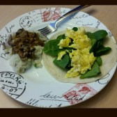 Scrambled eggs and spinach on a tortilla with a side of mashed potatoes/cauliflower topped with a mushroom sauce
