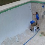 Base coat being applied to concrete