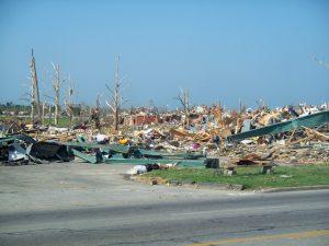 wood-frame home tornado damage