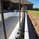 Vertical rebar extends from the footer into the walls.