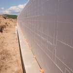 Long running ICF wall with spot foam