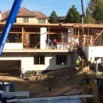 Crew works on the home after the ICF portion is completed