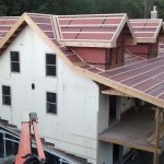 Finishing the roof installation.