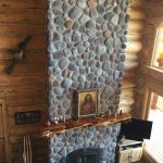 Large pudding stone fireplace in living room