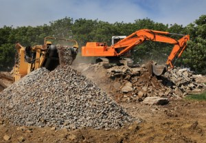 Excavator loading a crusher