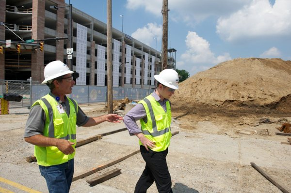 Tom Conti, left, talks with Paul Becks on the construction site.