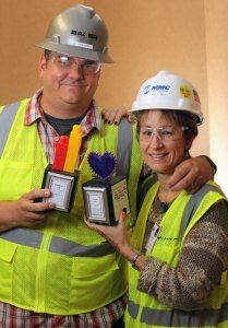 Rob Ford, estimator at Baker Concrete Construction, and Pam Best, director of pre-construction services at MMC Contractors, accepted the Purple Heart and Raising the Bar Awards on behalf of the team members working at the site to solve problems and ensure a safe environment.