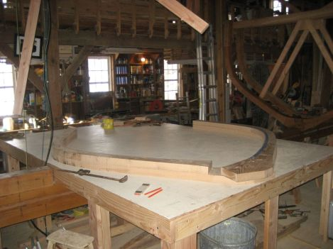 The temporary braces are removed (seen hanging overhead), and the two frame halves are separated for sawing bevels on both the inner and outer faces. Photo by Jim Trish.