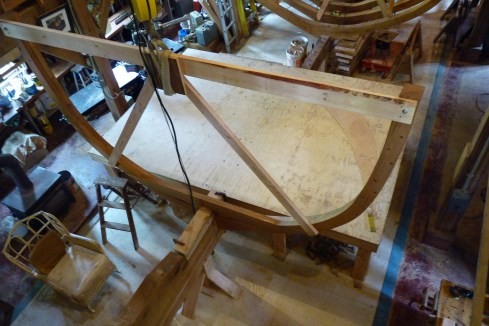 This frame and the next one forward get strongbacks which pass over the keelson. Since the keelson can't be put in at this point, the strongback was fitted over a temporary piece with the same cross section as the keelson