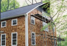 Roofing finished, siding underway