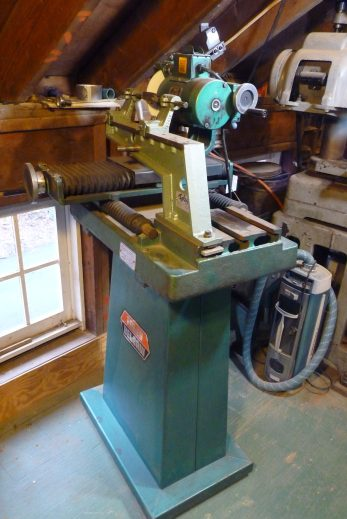 """Foley Model 367 Carbide Grinder. Here it's set up for a steel spiral cutter, but it normally has a diamond wheel and a different fixture used for carbide circular saws up to 40""""."""