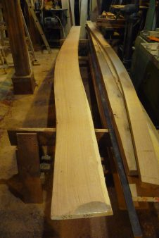 The first forward plank below the sheer plank is cut to shape and ready to flop over onto the natural crook board for tracing out it's twin for the opposite side. Wish we had more naturally curved boards like this!