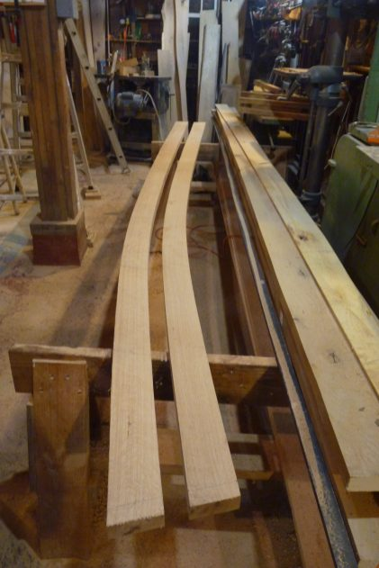 Port and starboard forward planks below the sheer plank, ready to steam-bend.