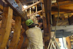 Ian and Josh finish clamping in the first plank below the sheer plank at the bow end.