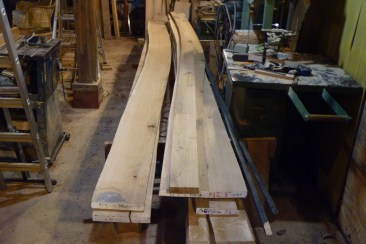 On right, forward plank (2nd strake) cut to shape. On left, natural crook board will be just right to get out the opposite side plank.