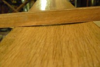 """This shows the hollowing of the inside of the planks, necessary to match the curvature of the frames they sit against. Boatbuilders call this """"backing out."""" On this plank, there is about an eighth inch hollow."""