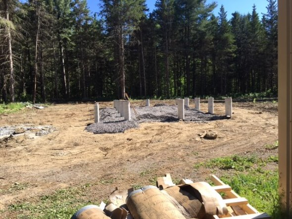 Concrete forms removed and ground leveled for tiny house