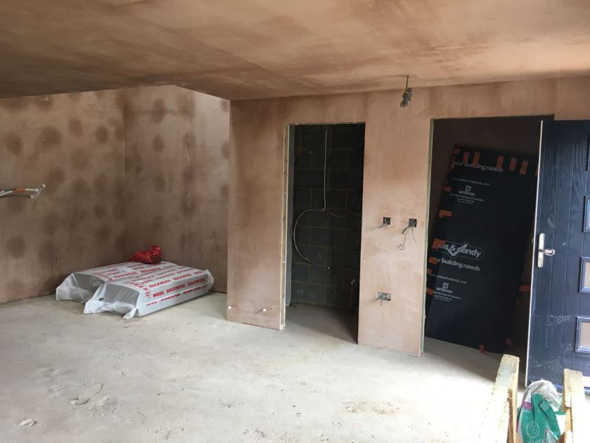 Ground floor plaster skimmed with dot and dab showing