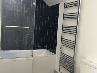Bathroom L-shaped bath fitted