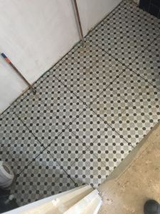 Downstairs cloakroom floor tiling