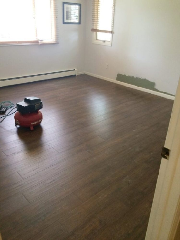 Pergo floor installation at our third flip house