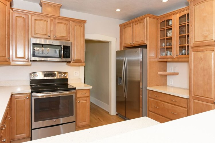 The kitchen is cleaned, including the fridge and is ready for the open house.