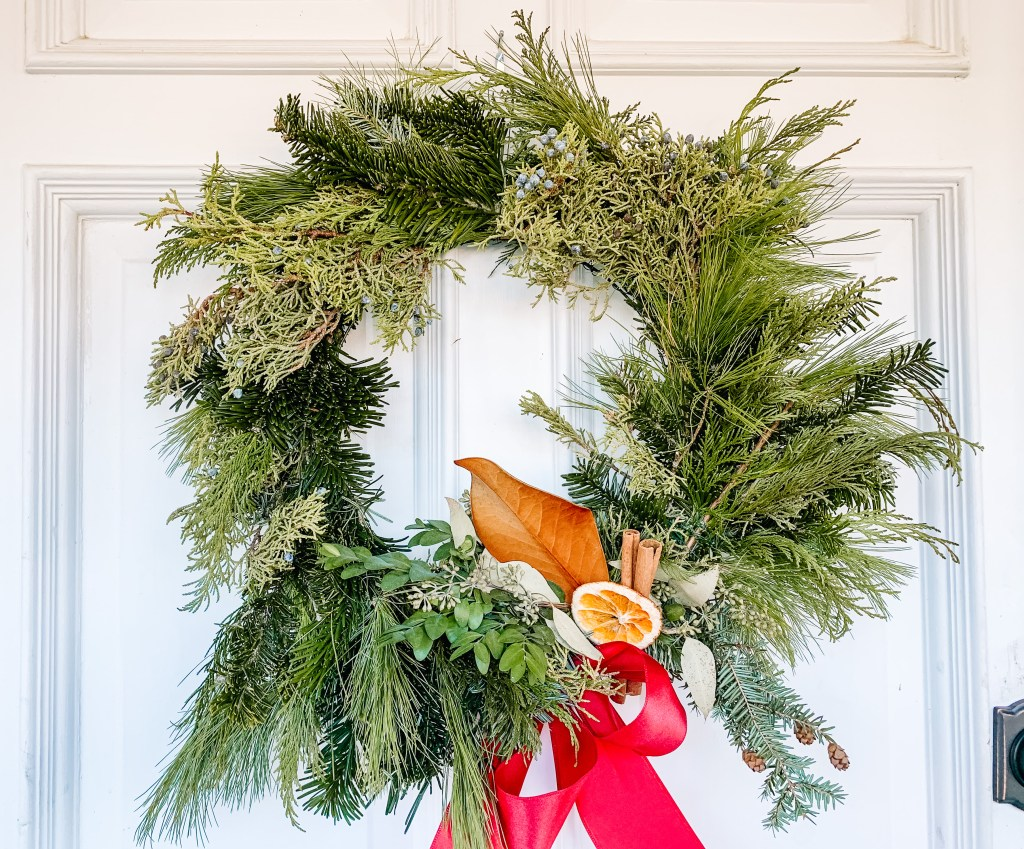 Holiday wreath with orange accent