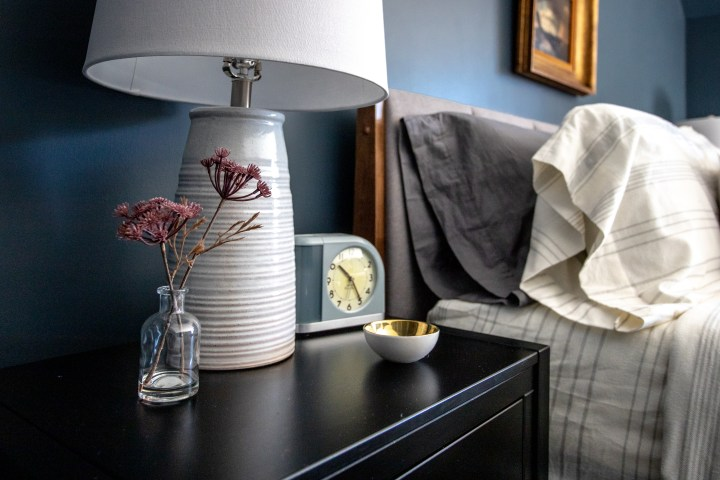Simple nightstand decor with family photos for a personal touch | Building Bluebird #moodybedroom #moodypaint #bhgorc #targetstyle
