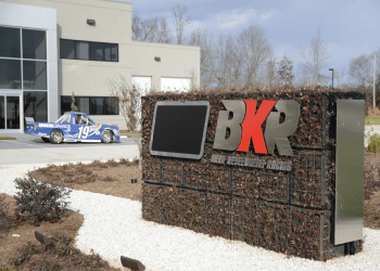 Brad Keselowski Racing Shop with Sign and car out front