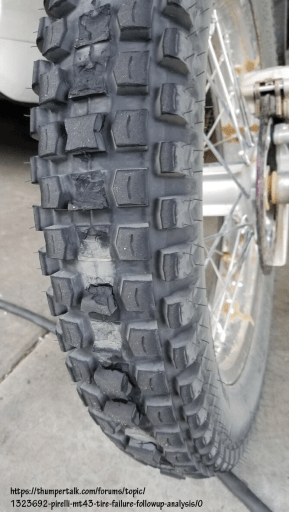 Chunking-type wear on a bicycle tire. Dirt tires for cars can exhibit the same wear patterns.