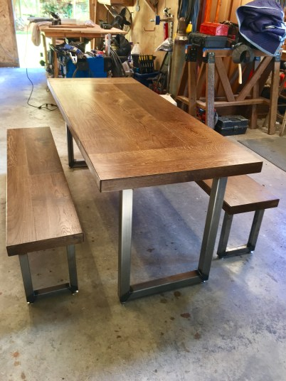 custom dining table with steel legs fabricated by daniel harmon