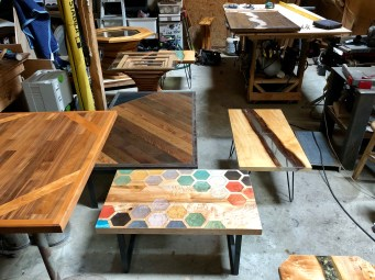 collection of custom tables with fabricated legs bainbridge island