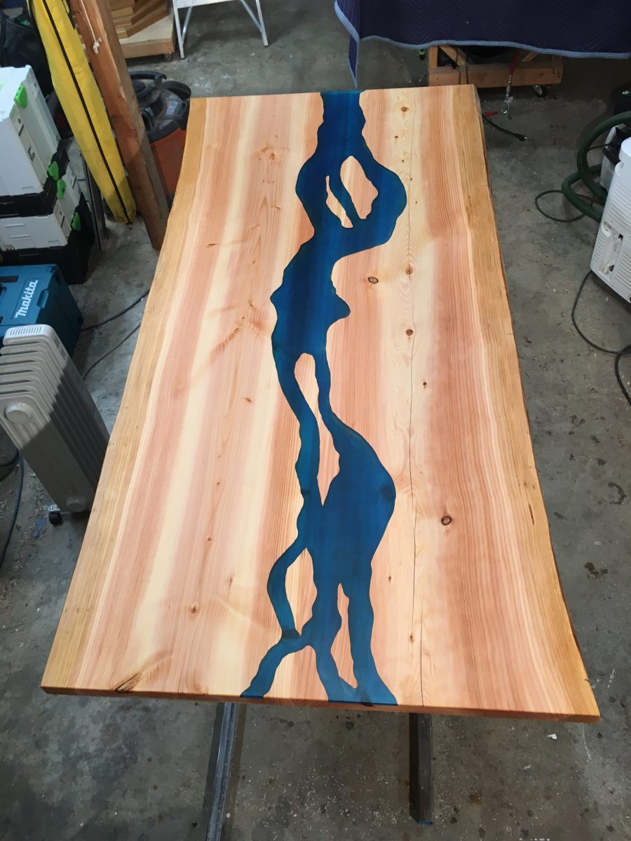 custom made river table with blue epoxy